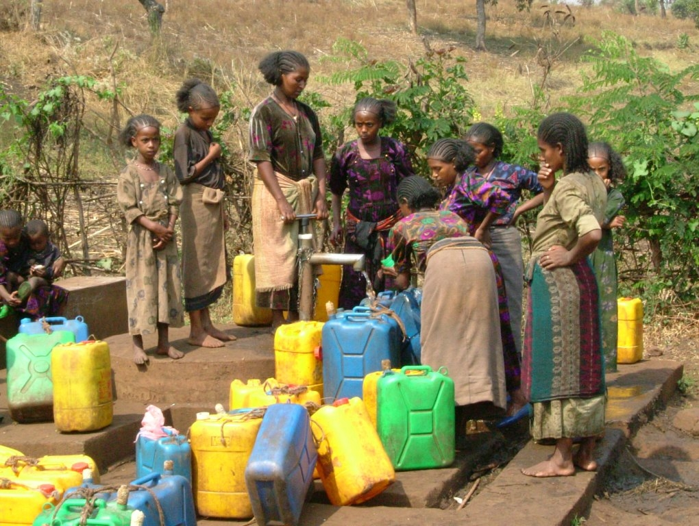 WOMEN WAITING FOR WATER