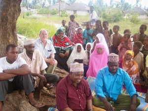 Village community in Pemba Zanzibar in conversation with their religious leaders Juma and Amhad [front] and Owen Lambert CSSp on the  HIV-AIDS crisis  for children